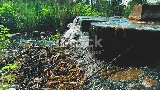 istock Artificial Concrete Water Cascade on Fast Flowing Stream 1336832289
