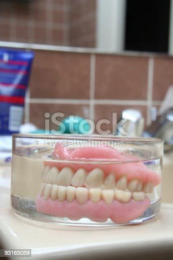 104545719istockphoto Artificial denture in a glass 93165059