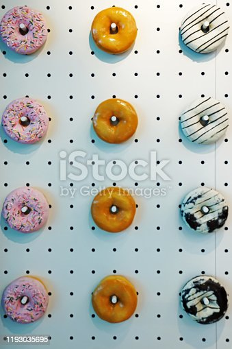 1136239089 istock photo Artificial donuts decorated on the wall 1193035695