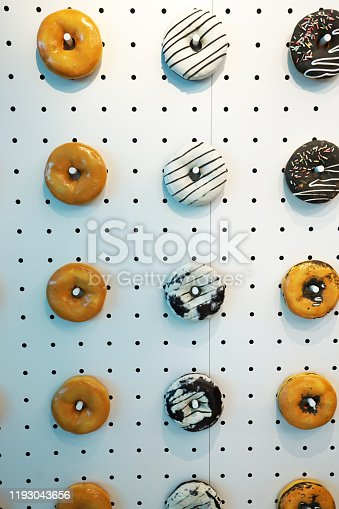 1136239089 istock photo Artificial donuts decorated on the wall 1193043656