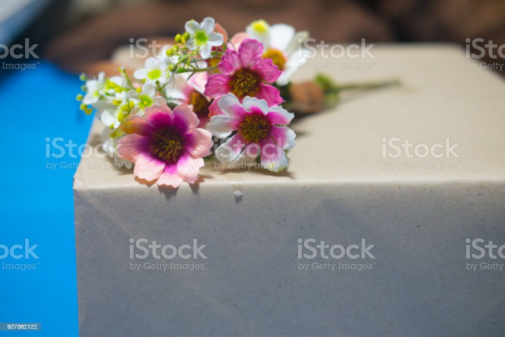 Artificial flower bouquet on handcraft gift box - Royalty-free Anniversary Stock Photo