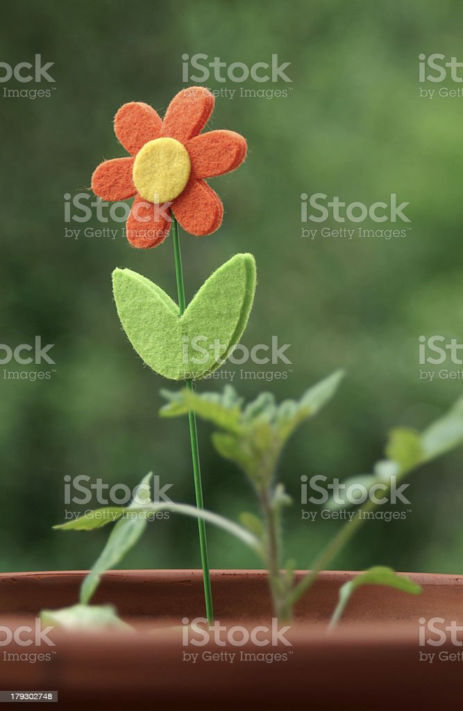 Artificial flower in a plant pot royalty-free stock photo