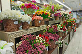 istock Artificial flowers are sold in the store. In baskets are bouquets of various artificial flowers for sale 1207122125