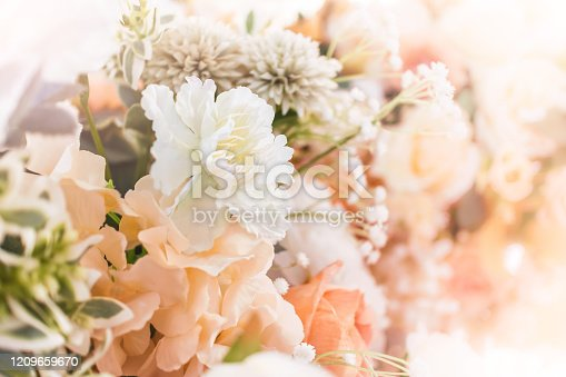 1129427811 istock photo Artificial flowers decoration background in vintage classic tone color 1209659670