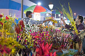 Kolkata, West Bengal, India - November 28, 2015: Selling and buying of artificial flowers made out of colored plastics, handicrafts on display during the Handicraft Fair in Kolkata. Biggest handicrafts fair in Asia.