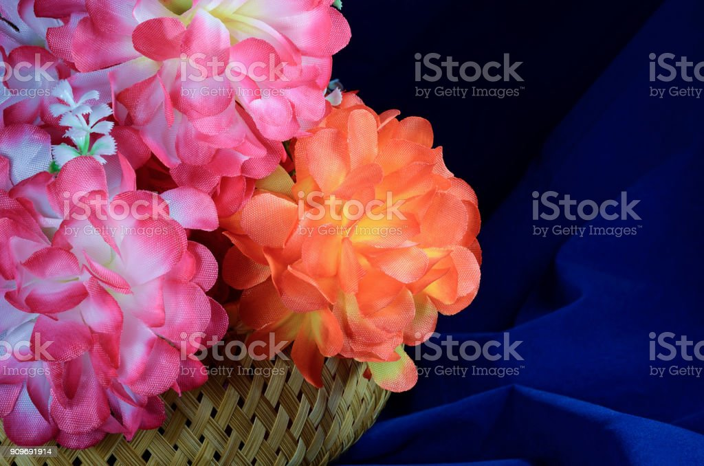 artificial flowers in basket stock photo