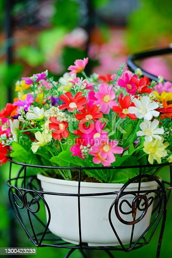 Closeup of colorful artificial flower bouquet decorated in basket