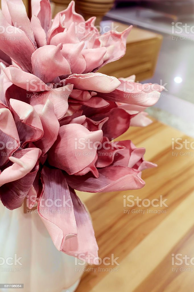 Artificial flowers in vase stock photo