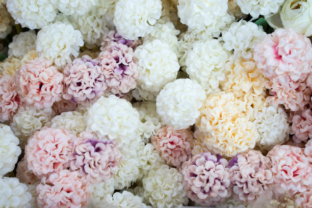 Artificial flowers on market stall stock photo