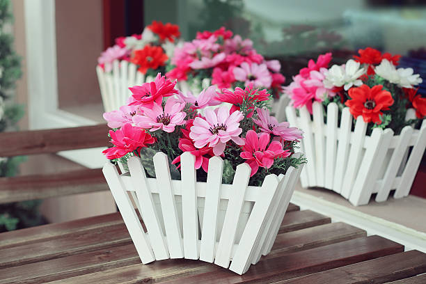 artificial flowers pot stock photo
