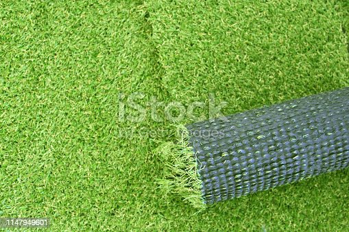 Artificial green grass laying background