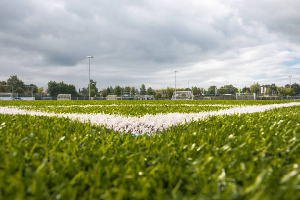 Artificial grass on a football playing ground Artificial grass on a football playing ground, very durable and long lasting, picture take in the Netherlands soccer field stock pictures, royalty-free photos & images