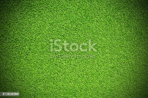 Close up of synthetic green grass texture vignette