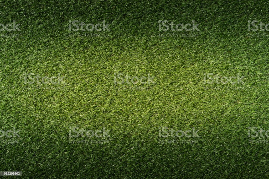 artificial green grass texture background stock photo
