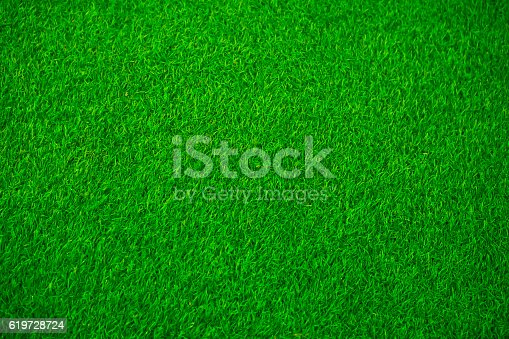 istock Artificial green grass texture for background 619728724