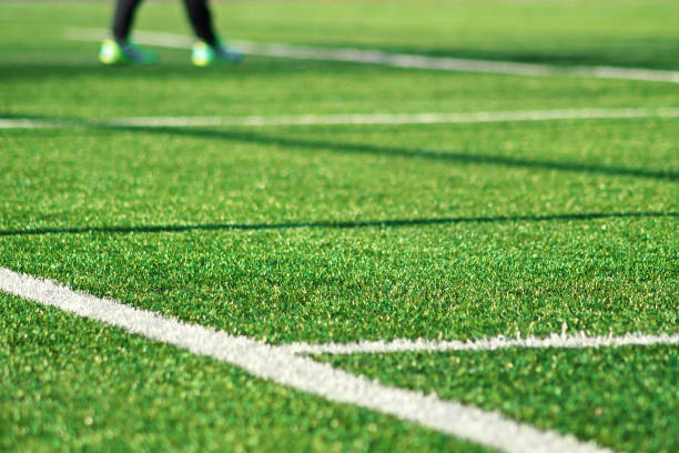 Artificial green grass with white stripe of soccer field Artificial green grass  with white stripe of soccer field. White line on green grass a field of play. Fake Grass used on sports fields for soccer and football. Closed-up of artificial grass background. turf stock pictures, royalty-free photos & images