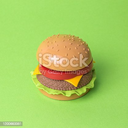 1156991909 istock photo Artificial hamburger with cheese tomatoes and lettuce abstract on green. 1200663351