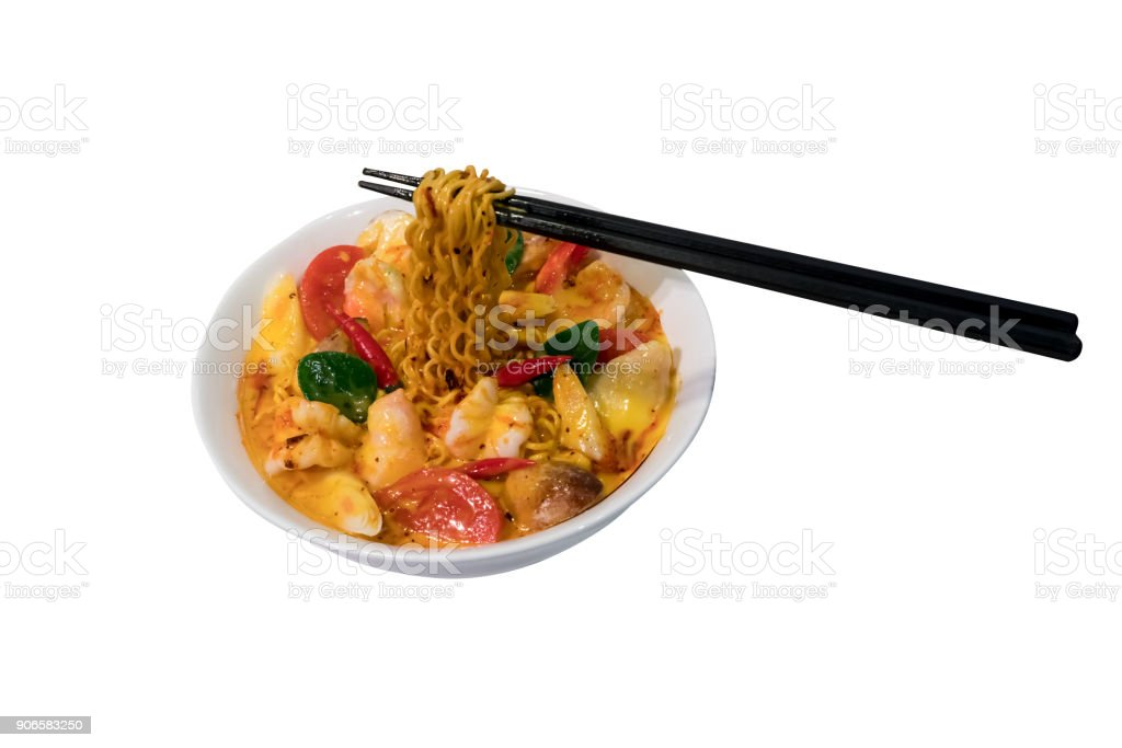 Artificial instant noodle with 'Tom-Yum', Thai spicy flavor with black chop sticks isolated on white with path selection. stock photo
