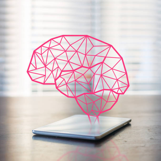 Artificial inteligence Tablet computer on a desk inside an office .  Pink abstract brain made from lines is shown on top of the tablet. autoreceptor stock pictures, royalty-free photos & images