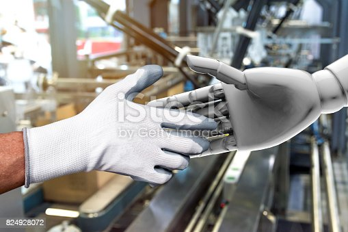 istock Artificial intelligence (AI) advisor or robo-adviser in smart factory industry 4.0 technology. Shaking hands of engineer and 3d rendering robot. Blur packaging factory background. 824928072