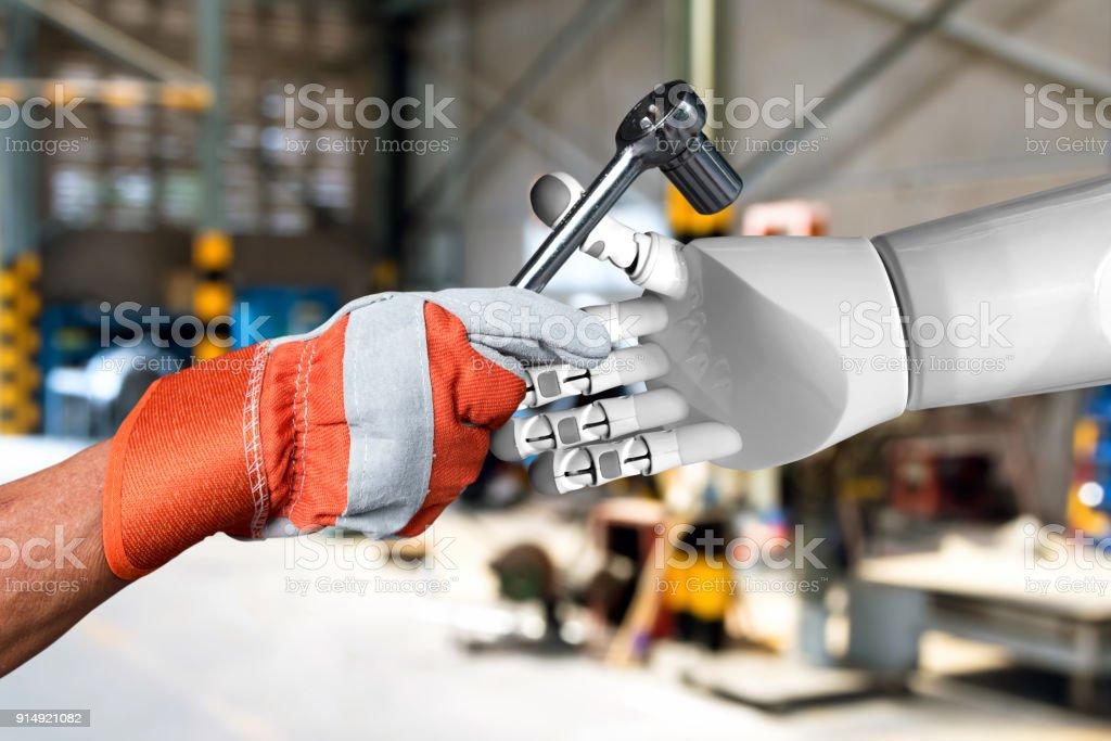 Künstliche Intelligenz (KI) Berater oder Robo-Berater in der intelligenten Fabrik Industrie 4.0 Technologie. Industrielle Welt der männlichen Ingenieur hand auf Schraubenschlüssel Werkzeuge zum Roboter. Weichzeichnen Sie Anlage-Hintergrund. – Foto