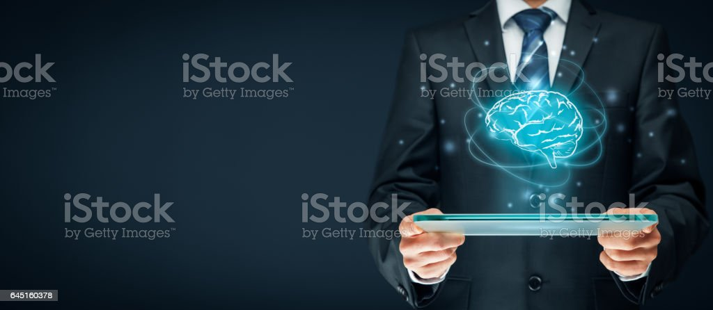 Artificial Intelligence AI Artificial intelligence (AI), machine deep learning, data mining, expert system software, and another modern computer technologies concepts. Brain representing artificial intelligence and businessman holding futuristic tablet. Adult Stock Photo