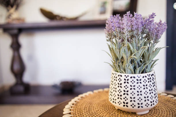 Artificial lavender vase on the side table in the living room stock photo