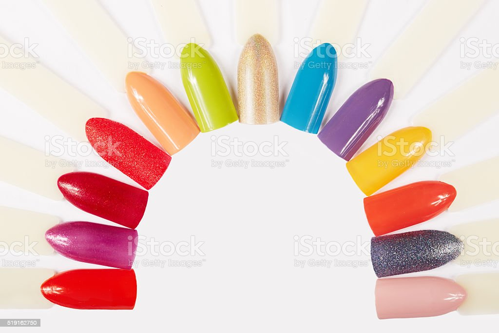Artificial nails different colored with nail polish stock photo