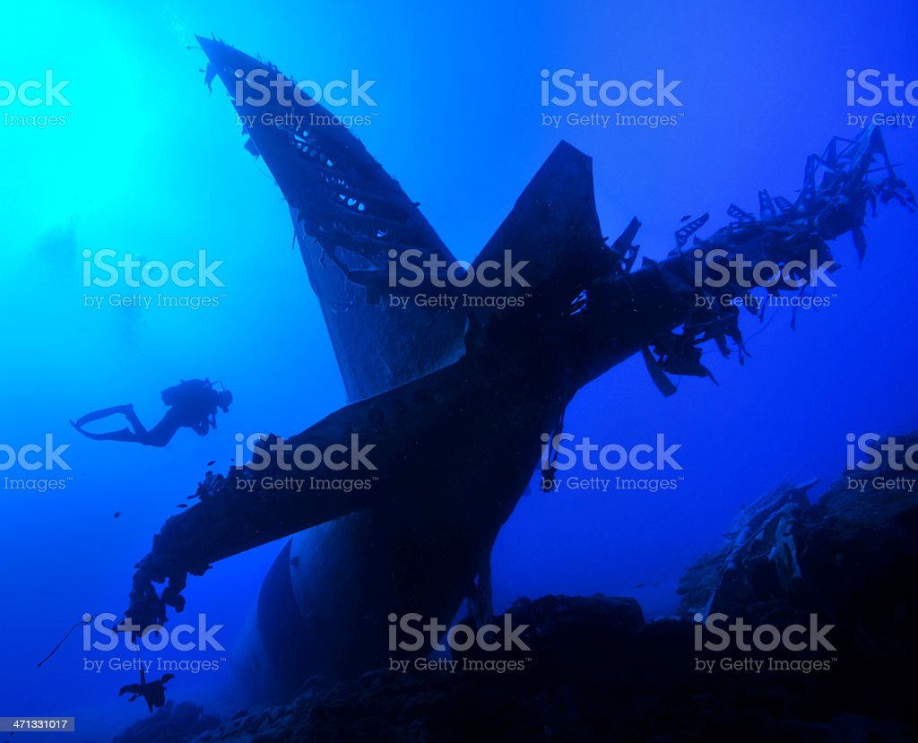 Artificial plane wreck and diver stock photo