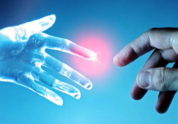 Artificial robot hand touch human hand stock photo