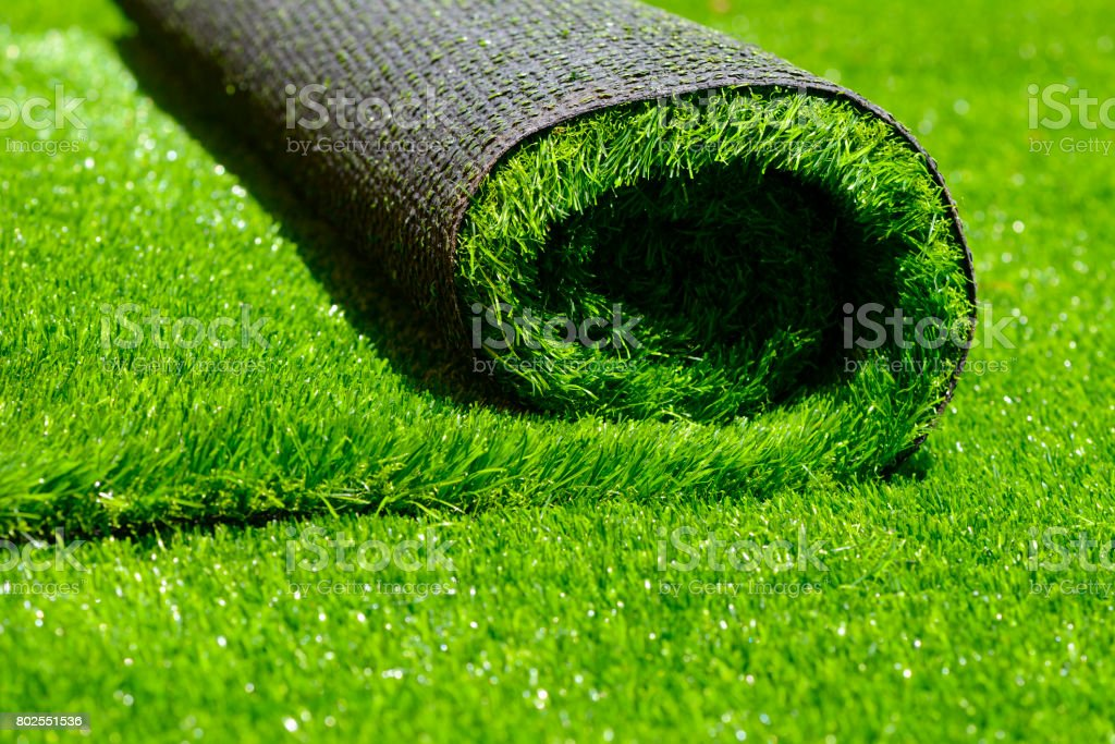 artificial rolled green grass stock photo