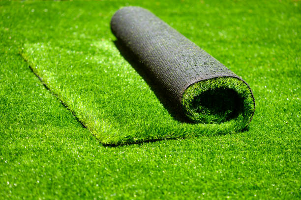 artificial rolled green grass - imitation stock photos and pictures