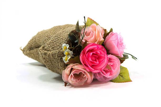Künstliche rose Blume bouquet in kleinen sack – Foto