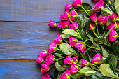 istock Artificial roses on wooden background. Mothers day card. 1130693213