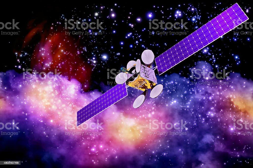 artificial satellite against nebula's background stock photo