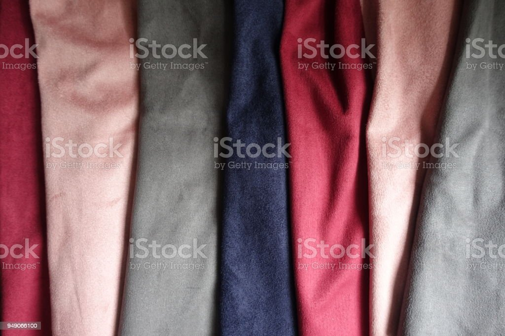 Artificial suede fabrics in different colors (folded) stock photo
