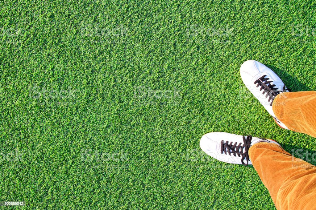 Artificial turf and Leg stock photo