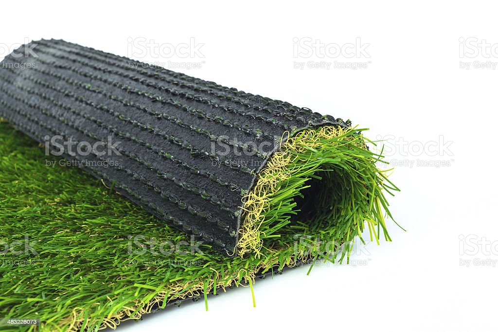 Artificial turf green grass roll on white background stock photo