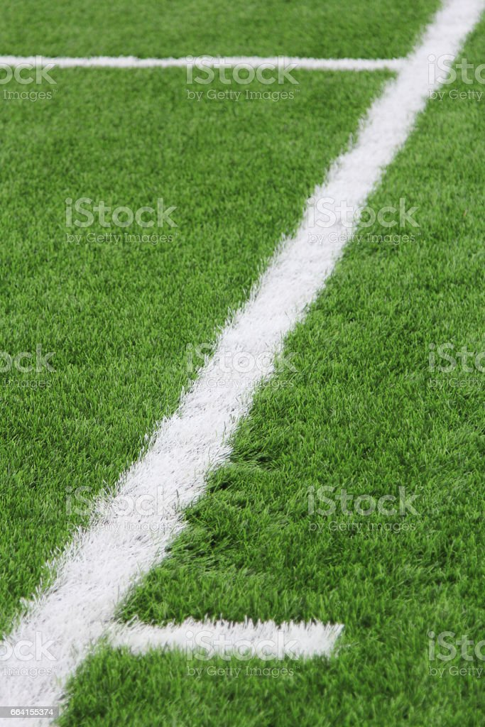 Artificial turf with markings on a football field. Sports background. foto stock royalty-free