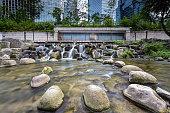 istock Artificial waterfall and rocks in Cheonggyecheon stream, Seoul, South Korea. Long exposure. 1332277776