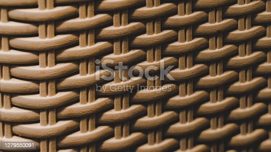 Artificial wicker interlaced with a checkered pattern, brown color