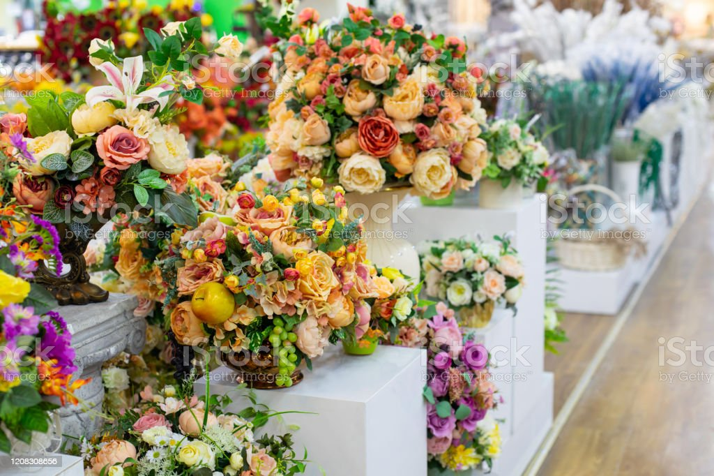 Artificial Yellow White Roses Bouquet With Leaves And Fruits Interior Design Bouquets In A Flower Shop Decoration Artificial Flower Fabric Rose Bouquet Backdrop Background Stock Photo Download Image Now Istock