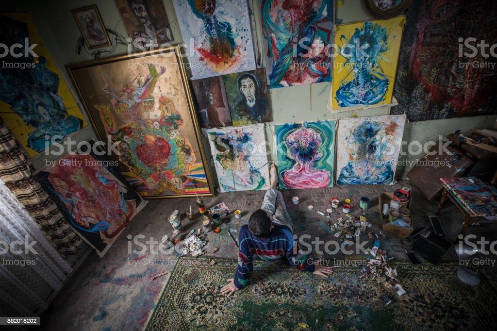 Artiist looking at paintings stock photo