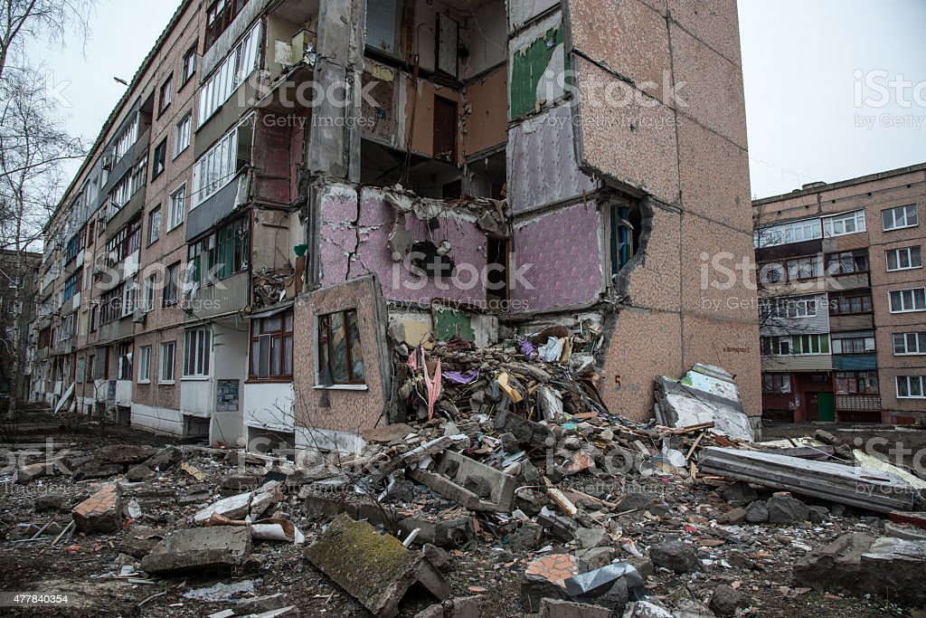 Artillery damaged apartment building in Lugansk stock photo