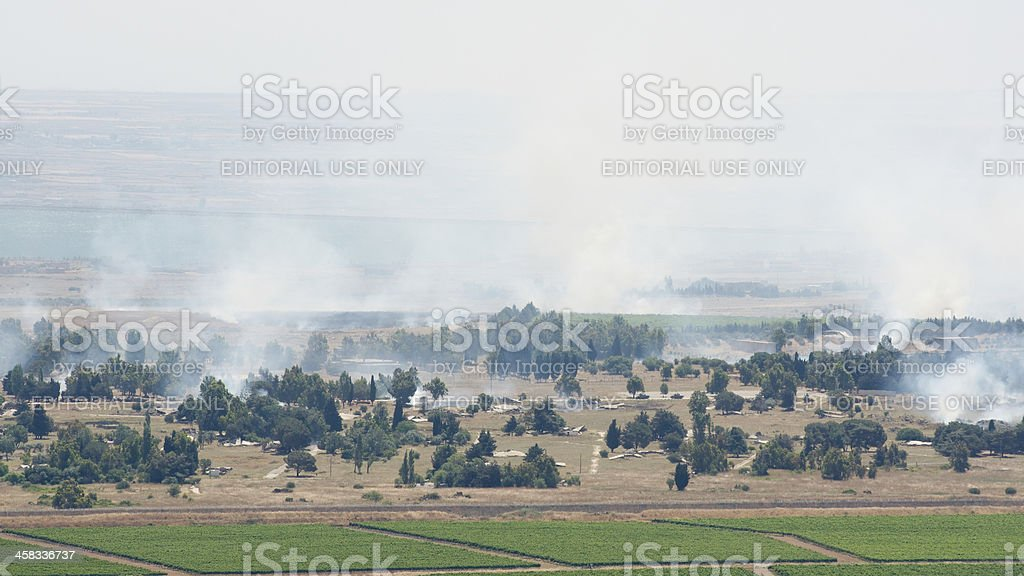 Artillery fire in Syrian city Al Qunaytirah on Golan Heights stock photo