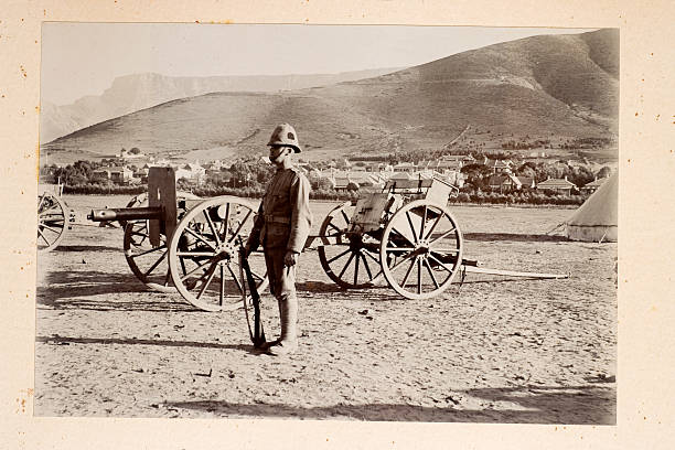 Artillery Vintage photograph of a cannon (early marchine gun) from the time of the Boer War mount combatant stock pictures, royalty-free photos & images