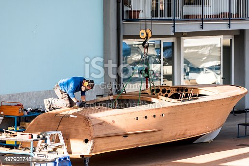 Salò (Brascia), Italy - October 26, 2015: Artisan at work in a shipyard in the construction of boat for the lake of Garda