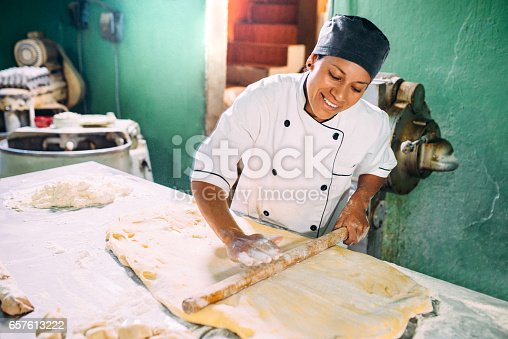 Baker kneading pastry dough.