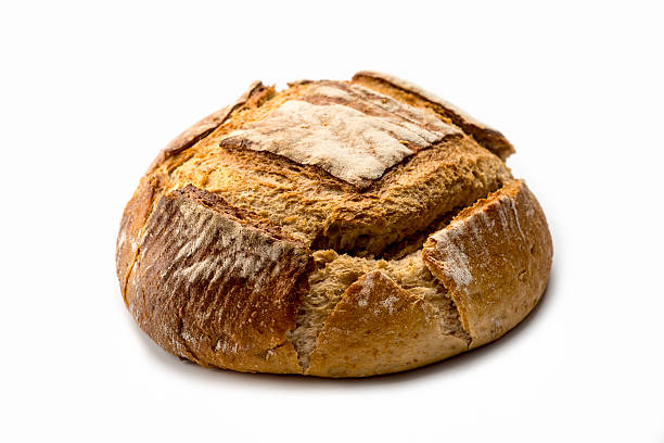 artisan  Bread Fresh loaf of homemade bread on white background round loaf stock pictures, royalty-free photos & images