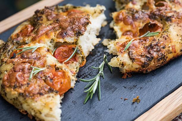 Artisan Focaccia Bread Pizza with Cherry Tomatoes, Pesto, Rosemary stock photo